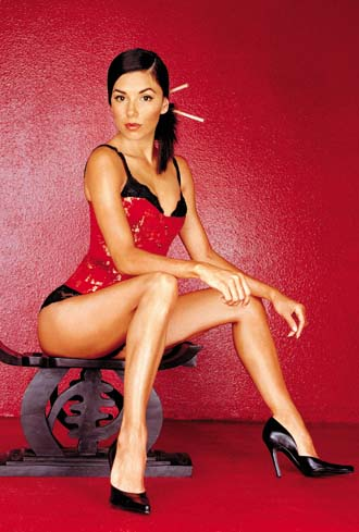 Eva Longoria sitting on bar stool