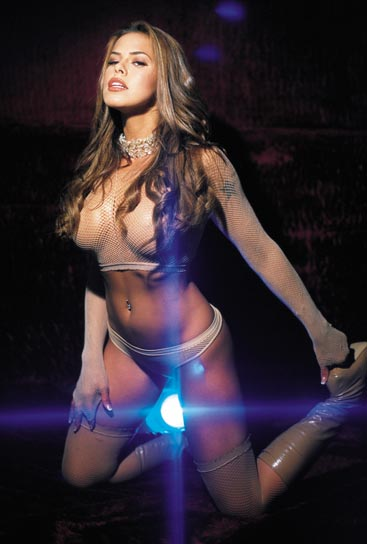 Rosa Blasi in lingerie posing in front of strobe light
